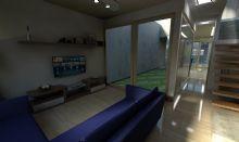 Vista da entrada da casa com jardim interno no meio e circulação para a cozinha ao fundo.
